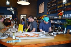 Shucking Oysters at the Bar